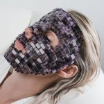 Face with amethyst face mask